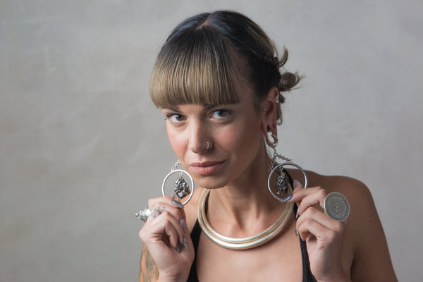 Woman wearing Tribalik Ear Saddles Jewellery for stretched ears
