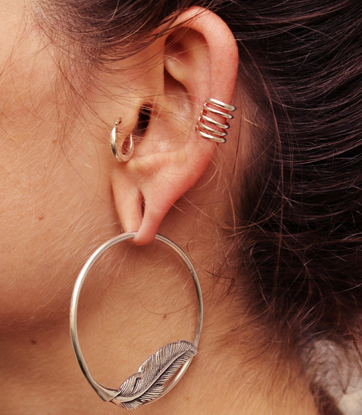 Tragus piercing Jewellery by Tribalik shown on close up of ear