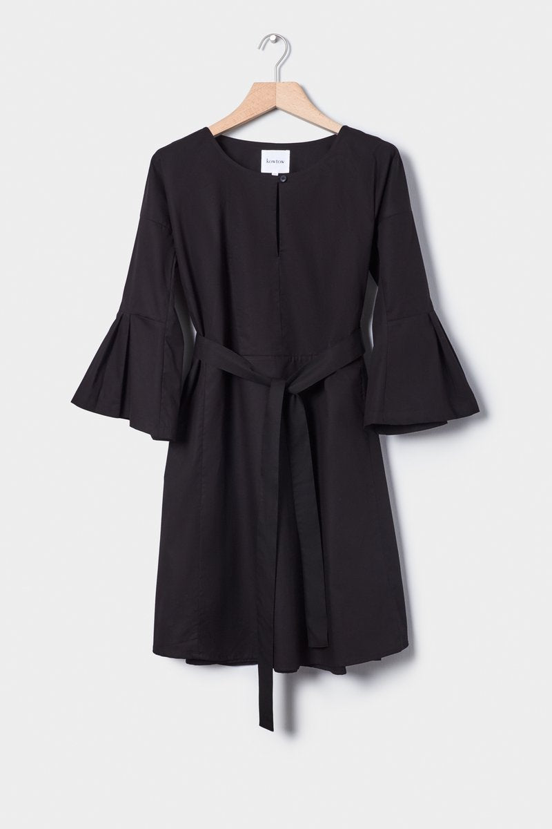 Kowtow Atrium Dress recycled hemp mid length flared and pleated sleeves