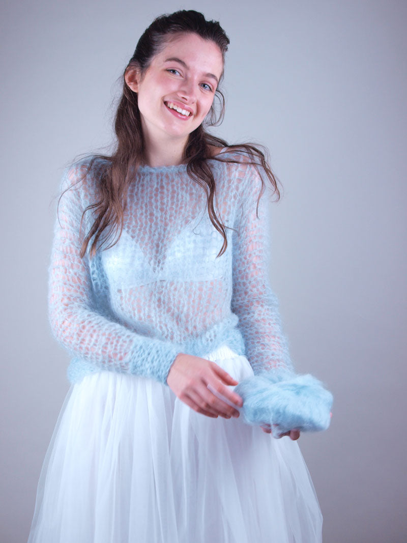 Light blue knit pullover look through for brides