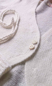 Knitting your own wedding jacket with golden knots