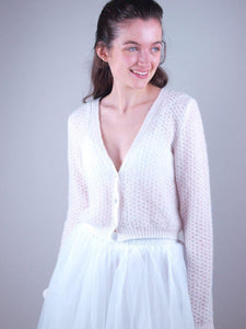 Bolero MIA knitted in a unique lace pattern with knots and soft wool