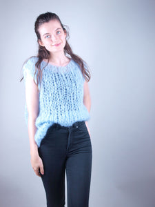 Pale blue vest knitted in mohair