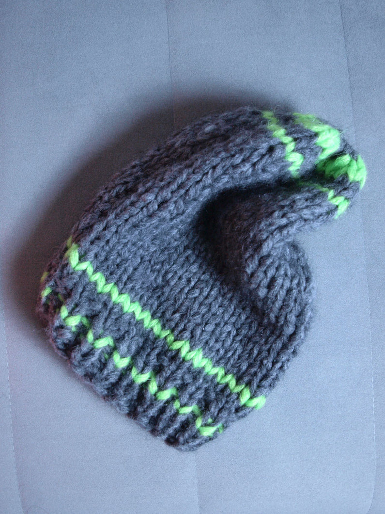 Gray hat handknitted with neon green