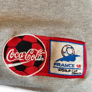 Vintage Coca-Cola Sticklogo Sweater WM '98 grau | M
