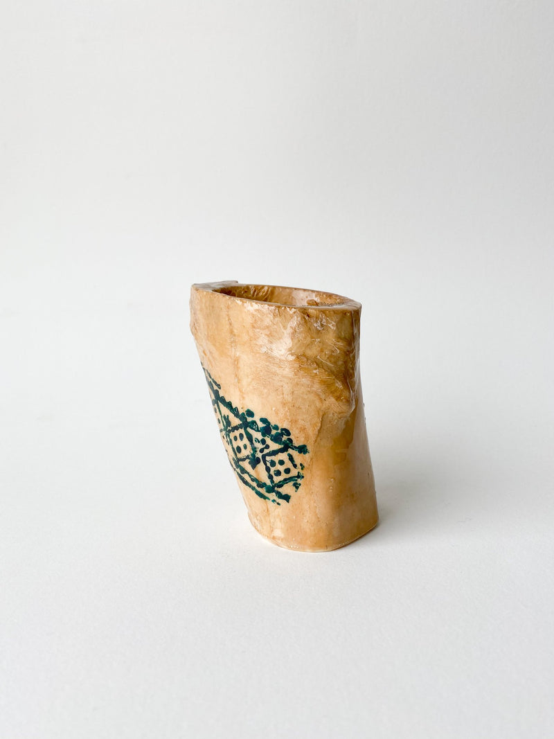 Cow bone segment with dark blue-green henna.