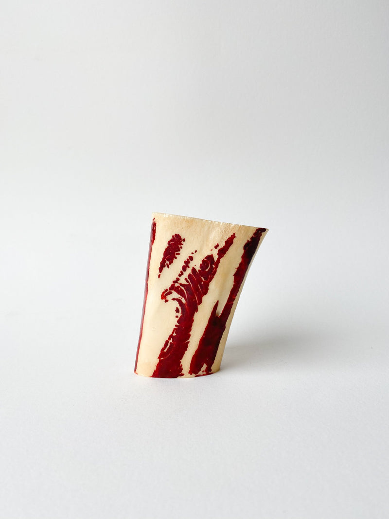 Cow bone segment with deep red henna.
