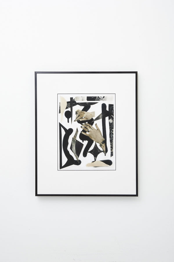 Collage of black and ivory forms, and hands on white background, framed, hung on wall.