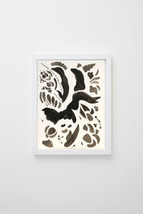 Abstract botanical forms in black and grey on white background, framed.