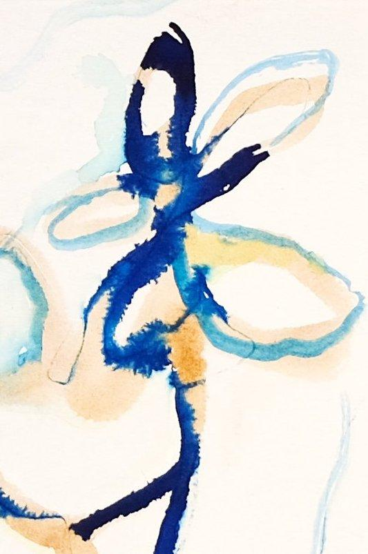Floral forms in yellow and blue on a white background, detail.