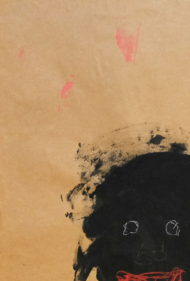 Head of Black figure with bright eyes and red lips on brown paper, head detail.