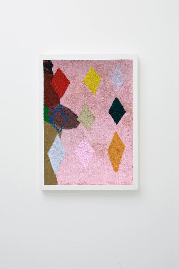Abstract multimedia art work showing geometric diamonds in a variety of colours on a light pink background. Framed on white wall.