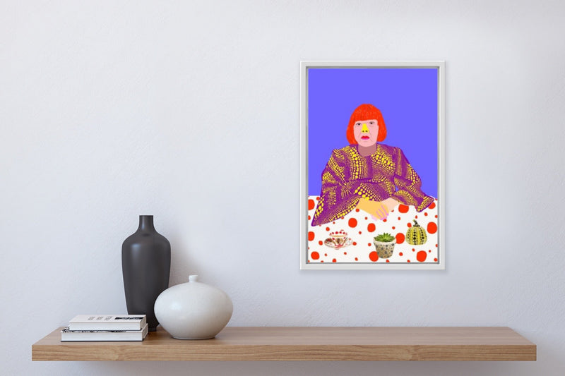 """Kusama Calmer"" (Colourful portrait of Yayoi Kusama at table with teacup and plant), framed in home."
