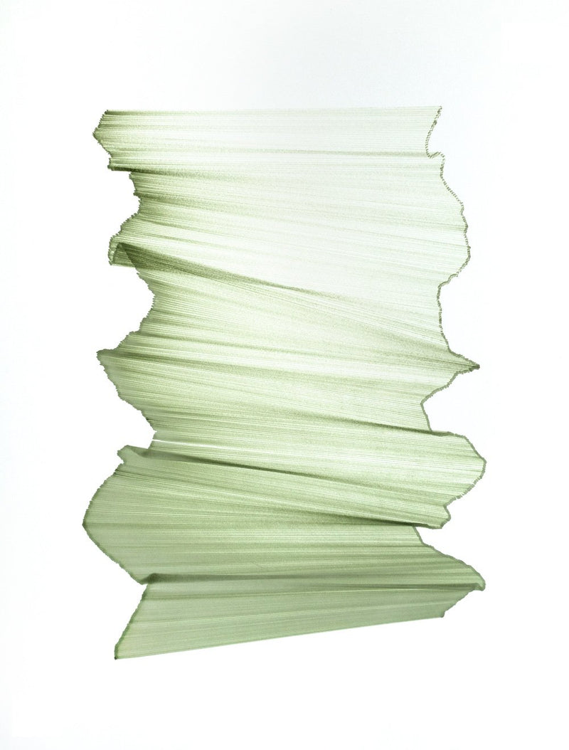 Green lines intersect on white paper, appear to float.