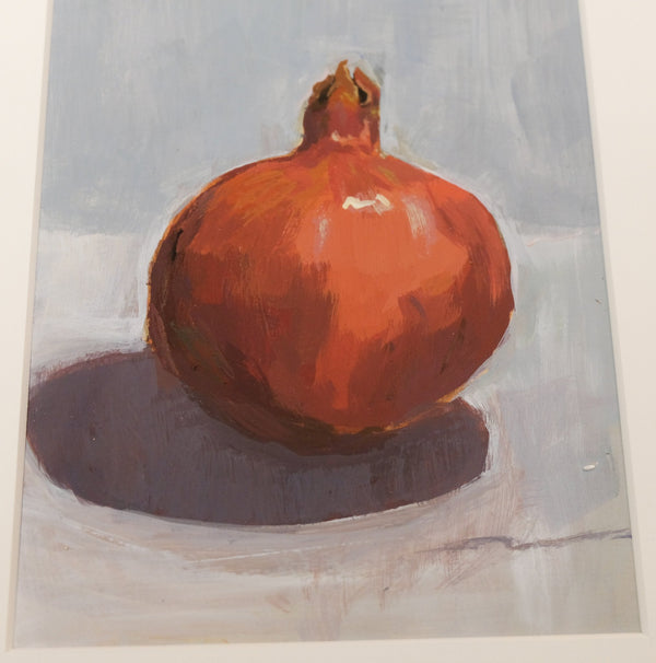 Realistic pomegranate on blue surface, detail of fruit.