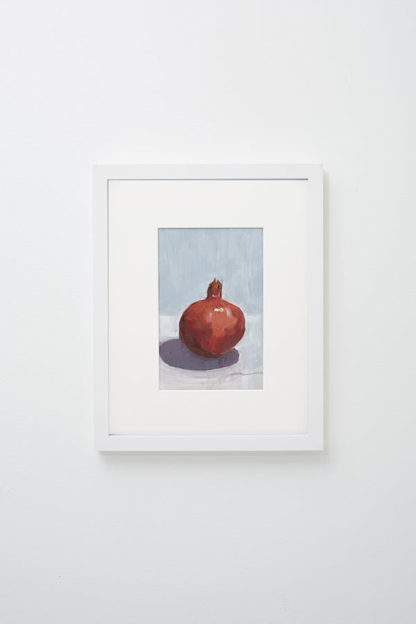 """Pomegranate Season"" (Realistic pomegranate on blue surface), framed."