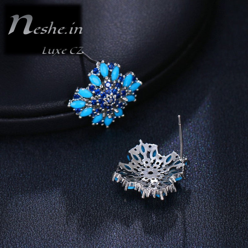 CZ Blue floral emitting shape stud earring