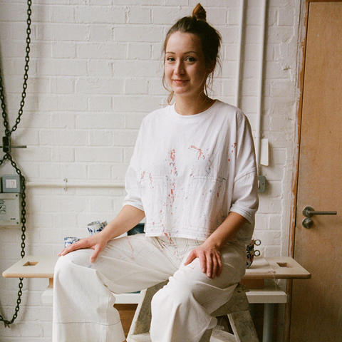 Anna makes small collections of functional ceramics, primarily mugs and homeware. She is interested in creating simple yet elegant forms with colours which complement each other, from soft pastel shades through to dark gritty hues.</p>Anna's drinkware collections are slipcast in porcelain and stains are added in order to create colour to the clay body. Glaze is often applied on the inside for function with the outside left unglazed yet smooth, creating a tactile juxtaposition between surface qualities.</p>Her homeware collection of large architectural planters are hand-built using heavily grogged clay which gives a textured surface to the simple forms.</p>Anna is the co-founding member of Clay Collective, a 12 member ceramics co-operative based in Hackney.