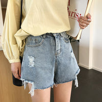 'Cut out' distressed denim shorts