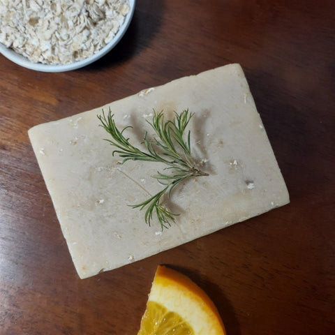 handcrafted double ipa soap displayed with herbs