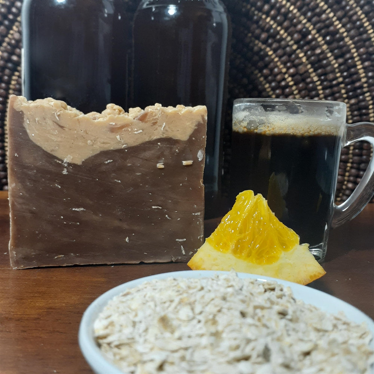 Beauty by Francesca Chocolate Oatmeal Stout Beer Soap dispalyed with orange and oats