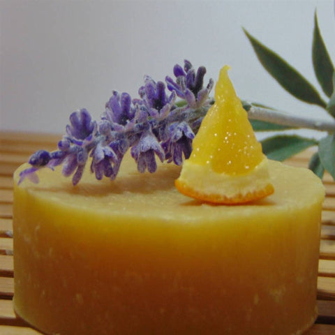 Lavender Orange Coconut Milk Soap dispplayed with lavender and orange