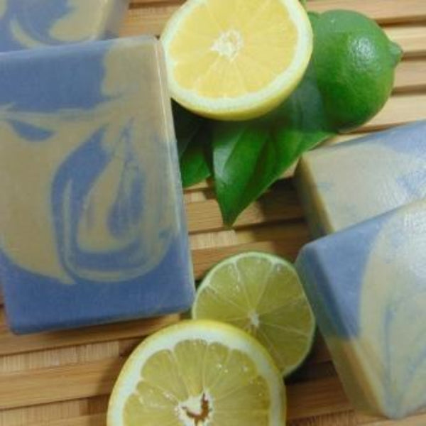 Charcoal Clay Soap displayed with lemons and lime