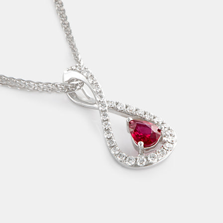 0.25ct Pear Ruby Infinity Twist Pendant with 18K White Gold and Diamonds