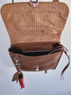 Cross Body handbag with a texture lid in a dark honey colour