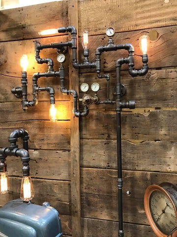 steampunk pipe art with light bulbs