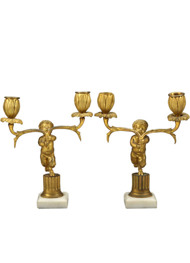 A Pair of French Antique Bronze & White Marble Figurative Candle Holders