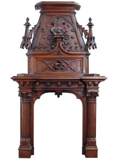 A Monumental 19th century Gothic Style Carved Walnut Fireplace