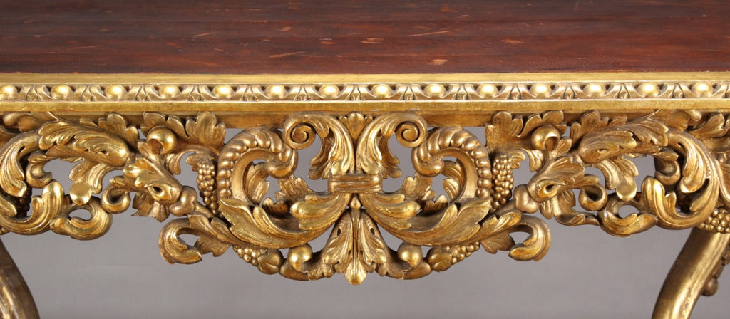 A French Rococo Style Gilt-Wood Leather-Top Center Table