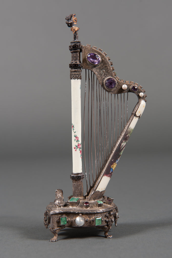 A Viennese Enamel & Jeweled Silver-Gilt Harp Form Small Timepiece