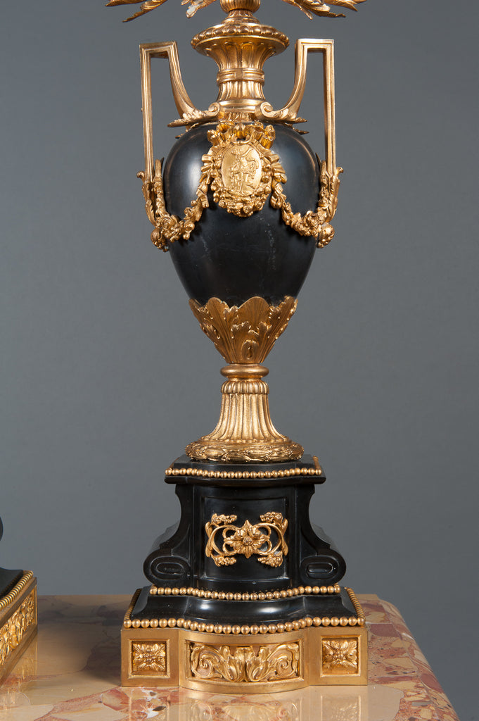 A French Ormolu Bronze & Black Belgian Marble Clock Garniture by Clodion