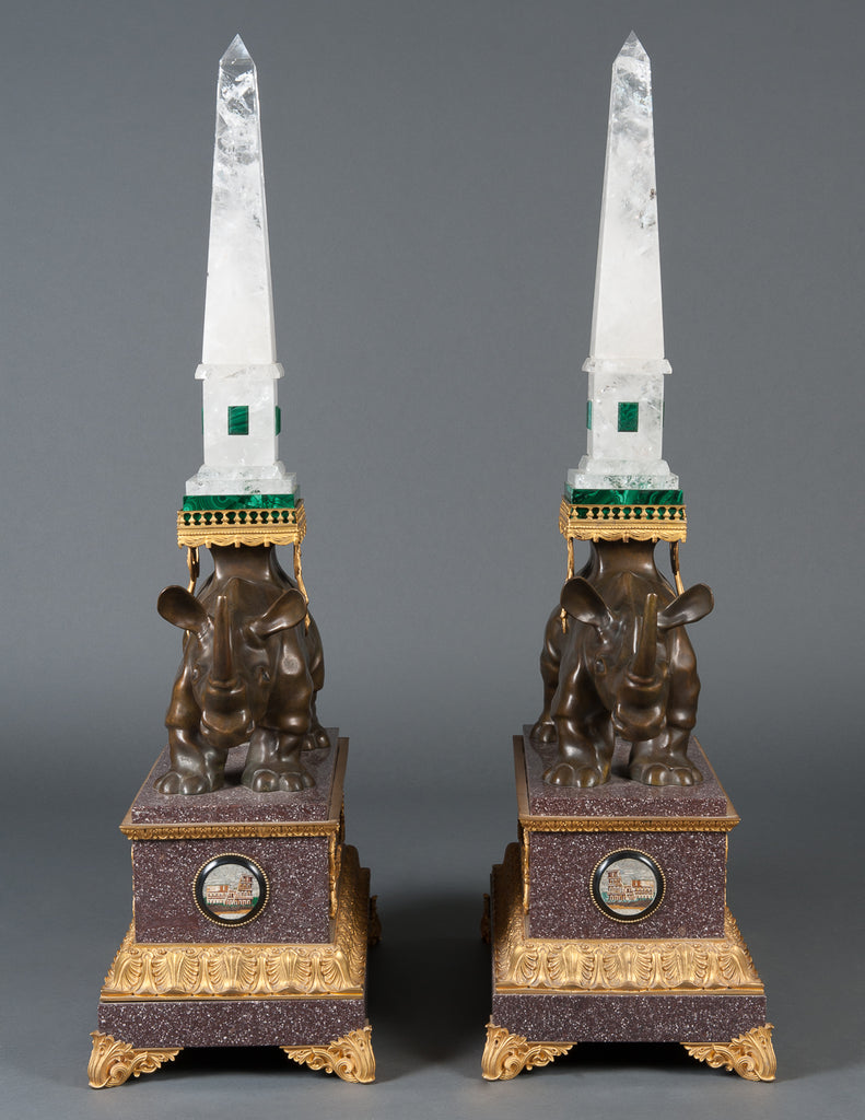A Pair of Louis XVI Style Bronze Rhinoceros Figures with Rock Crystal Obelisks