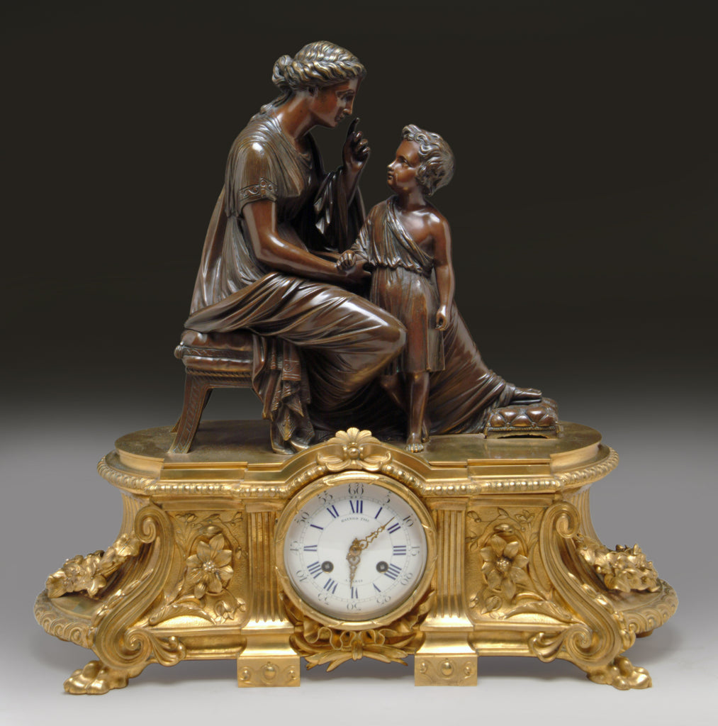A 19th Century French Gilt & Patinated Bronze Figural Mantel Clock