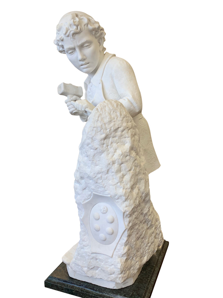 marble figure of Michelangelo carving the head of Faun