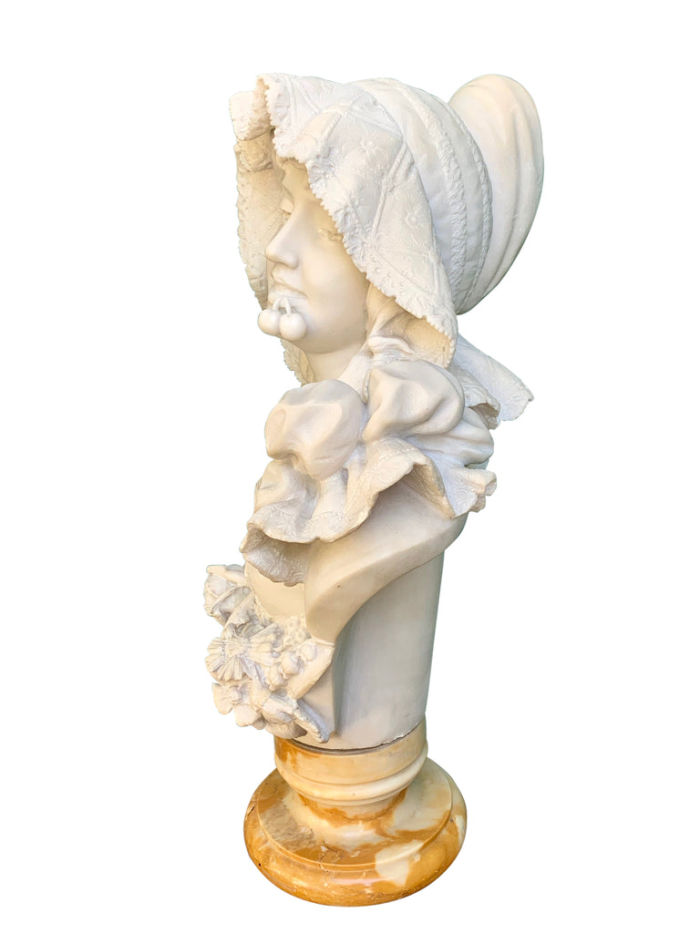 marble bust of a lady with cherries