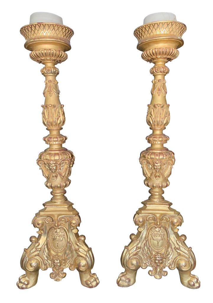 A Pair of monumental Italian carved giltwood torcheres
