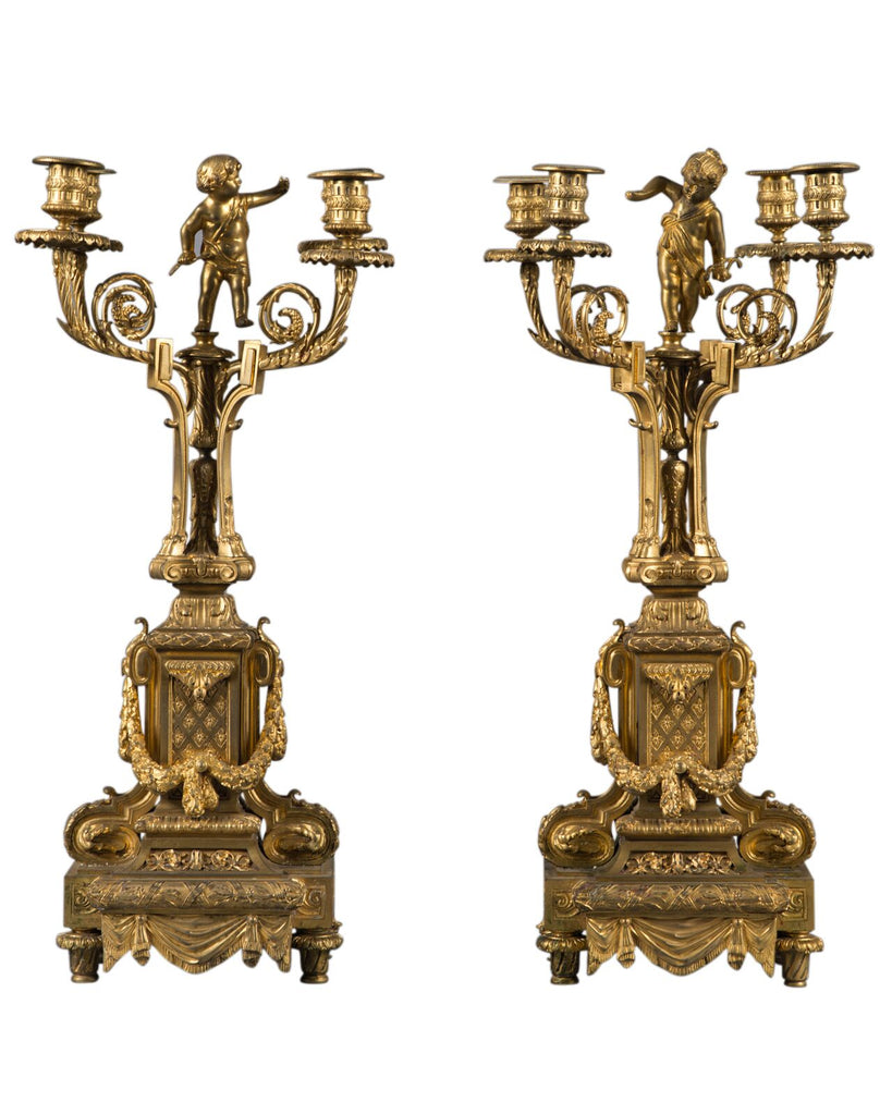 Pair of French ormolu candelabras with cherub on top