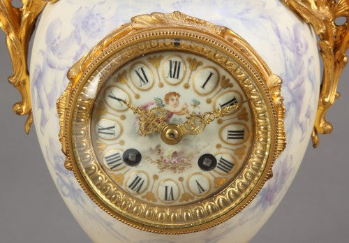 A French Sevres Figural Garniture Clock Set