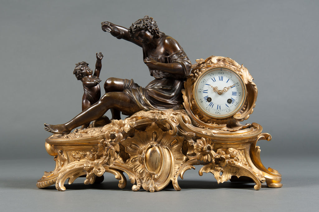 A Late 19th Century French Gilt and Patinated Bronze Figural Mantle Clock