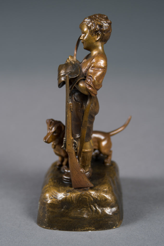 An Antique Austrian Bronze Figure of a Boy with His Dog and a Rifle