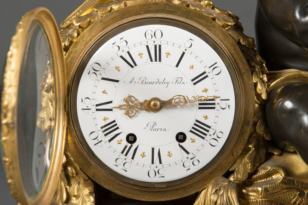 A French Rouge Marble Gilt and Patinated Bronze Mantel Clock by Alfred Beurdeley