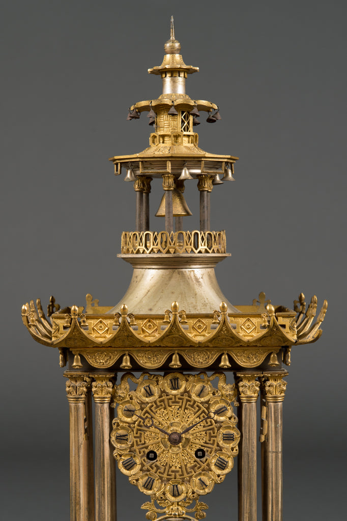A Fine French Silver and Gilt Bronze Three-Piece, Chinese Motif Clock Garniture