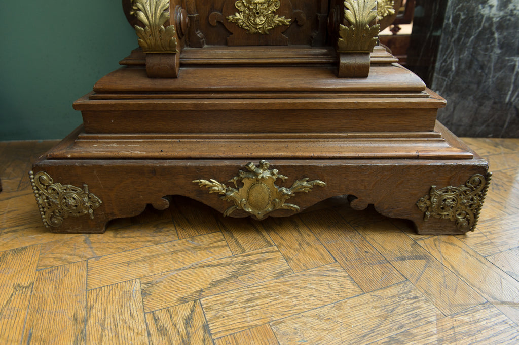A Fine Austrian Antique Patinated and Ormolu-mounted Carved Oak Regulator