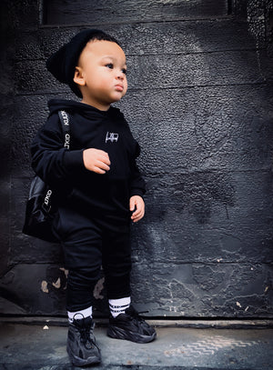 black oversized tracksuit for kids, children and baby. Best streetwear hoody and jogger co-ord set for little boys and girls.
