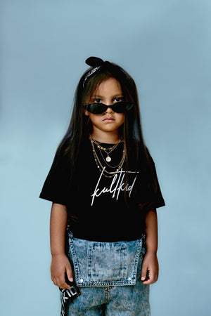 Little girls oversized black tshirt with signature designer logo
