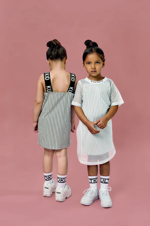 White tshirt dress with mesh overlay for little girls.